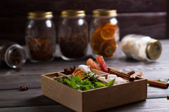 Tea box on a background of glass jars with spices. Stock Images