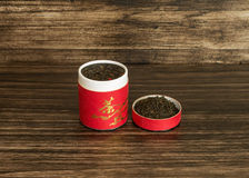 Tea in a box. On a wooden background Royalty Free Stock Photos