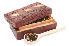 Tea box with wooden spoon Stock Photography