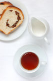 Tea and bread. With milk Stock Image