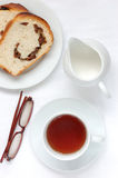 Tea and bread. Milk spectacles Royalty Free Stock Photography