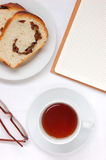 Tea and bread. Milk, spectacles Stock Photography