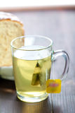 Tea and bread Stock Photography