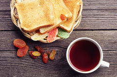 Tea, bread and dried fruit Stock Images