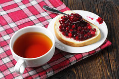 Tea and bread with jam Royalty Free Stock Photography