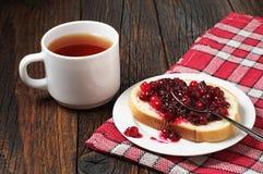Tea and bread with jam Stock Photos