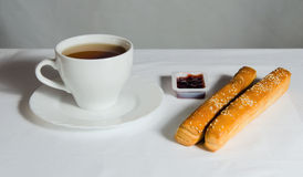 Tea and bread with jams Stock Photos