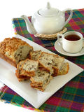 Tea with bread of nuts Royalty Free Stock Photography
