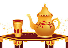 Tea Break. Arabic teapot and golden glass Stock Photos
