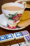 Tea Break - Domino. Relaxing cup of tea and a game of domino's royalty free stock photography