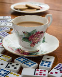 Tea Break - Domino. Relaxing cup of tea and a game of domino's stock photography