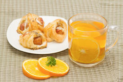 orange tea with little  croissant Royalty Free Stock Image