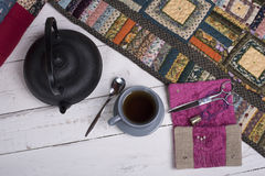 Tea break during the quilting. Of patchwork Stock Photography