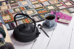 Tea break during the quilting. Of patchwork Stock Images