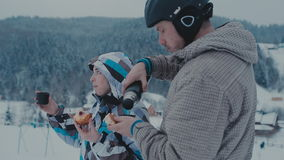 Tea break during skiing on the mountain. Man and woman drinking tea at a ski resort stock video footage