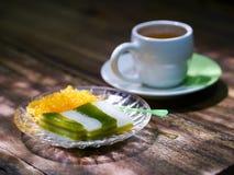 Tea break, Thai sweetmeat layer cake traditional wooden background. Tea break, Thai sweetmeat layer cake traditional wooden table background Stock Images