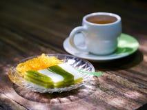 Tea break, Thai sweetmeat layer cake traditional wooden backgrou. Tea break, Thai sweetmeat layer cake traditional wooden table background texture Royalty Free Stock Images