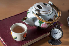 Tea break time,drinking with reading. Royalty Free Stock Photo