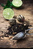 Tea brew with lime and mint on wooden background Royalty Free Stock Photos