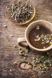 Tea brewed with chamomile in ceramic mugs Stock Images