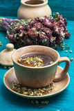Tea brewed with chamomile in ceramic mugs Stock Image