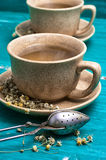 Tea brewed with chamomile in ceramic mugs Royalty Free Stock Photos