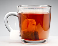 Tea brewing in cup Royalty Free Stock Photo