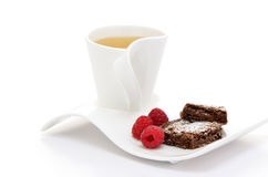 Tea with brownies and raspberries Stock Photo