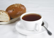 Tea and bun. Two buns and a cup of tea Royalty Free Stock Image
