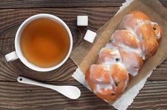 Tea and bun Stock Image