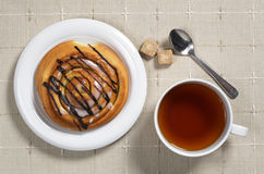 Tea and bun Royalty Free Stock Photo