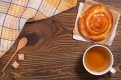 Tea and bun Stock Photography