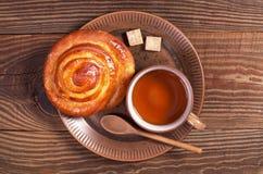 Tea and bun Stock Photo