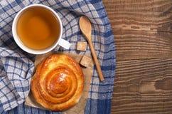Tea and bun Stock Images