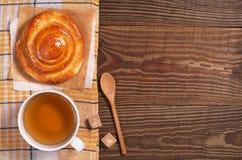 Tea and bun Stock Photos
