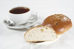 Tea and buns. Two buns and a cup of tea Royalty Free Stock Photos