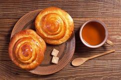 Tea and buns Stock Photos