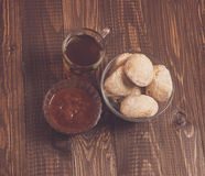 Tea, buns and a jam on a table Royalty Free Stock Photography