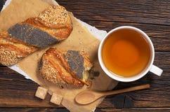 Tea and buns with seeds Royalty Free Stock Photos