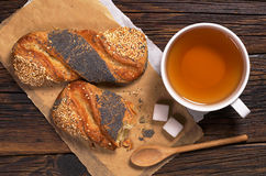 Tea and buns with seeds Royalty Free Stock Photography