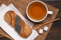 Tea and buns with seeds Royalty Free Stock Image