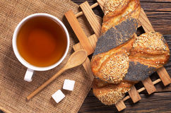Tea and buns with seeds Stock Photo