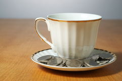 Tea bussiness. A cup of tea and some rmb on the office desk Royalty Free Stock Photo