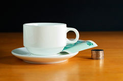 Tea bussiness. A cup of tea and some rmb on the office desk Royalty Free Stock Images