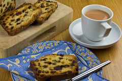 Tea and Cake. A cup of tea and a slice of fruit loaf cake Stock Images