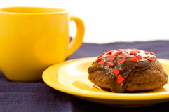 Tea and cake. Chocolate cake on the yellow plate and cup of tea stock photo