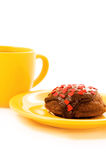 Tea and cake. Chocolate cake on the yellow plate and cup of tea stock image