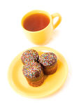 Tea and cake. Chocolate cake on the yellow plate and cup of tea royalty free stock photography