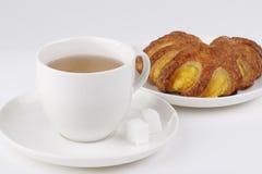 Tea and cake with banana jam. Teacup and cake with mango and banana jam Stock Images