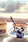 Tea with cake. Black tea with a slice of cake Royalty Free Stock Photo